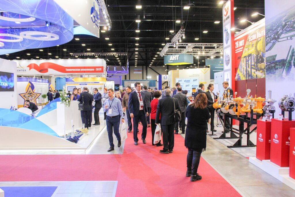 Visitors among the stands of companies.