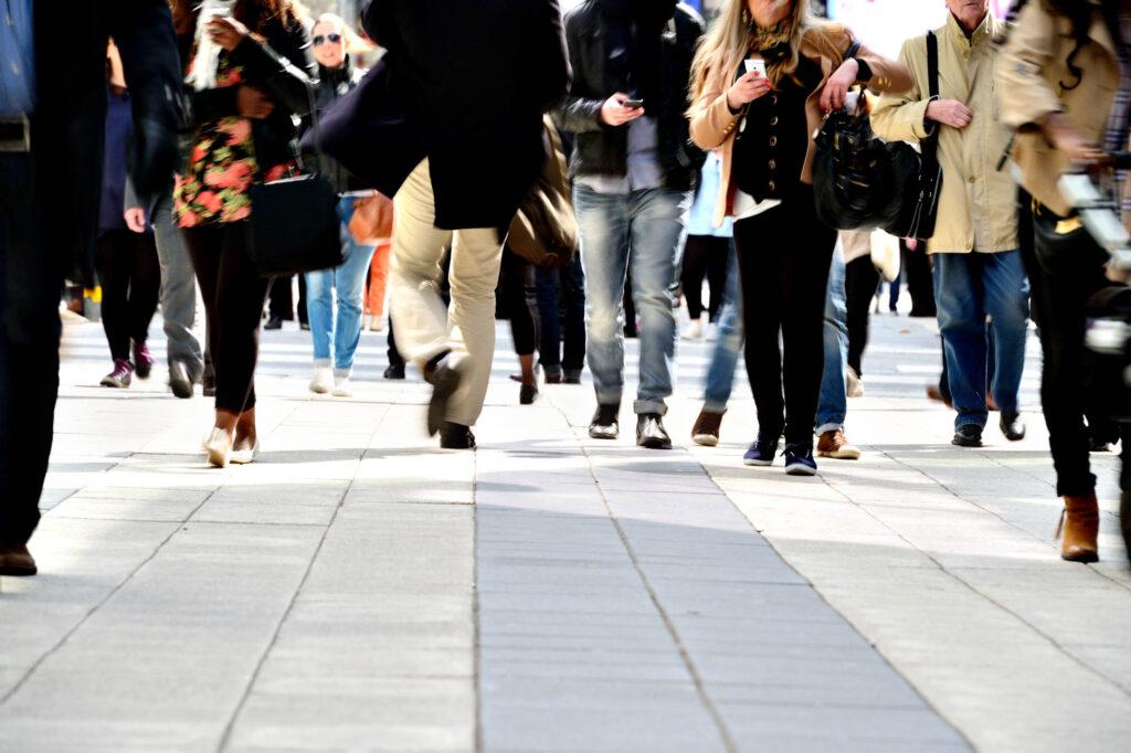 Pedestrians on tiled sidewalk.
