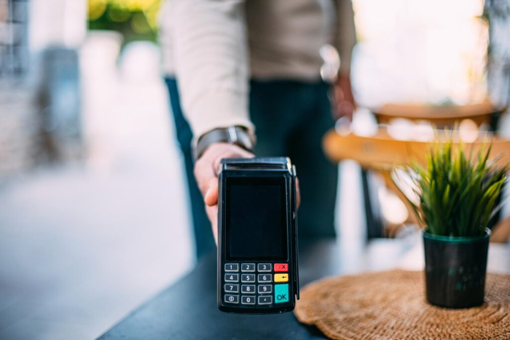 Waiter Holding Pos Device For Contactless Payment